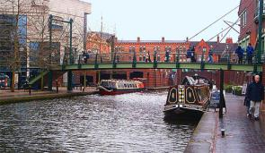 The Birmingham Canal Navigations Main Line Canal between the International Convention Centre (left), Brindleyplace (right), and Broad Street Tunnel (ahead) in central Birmingham, England. A part of the canal originally called Deep Cutting.
